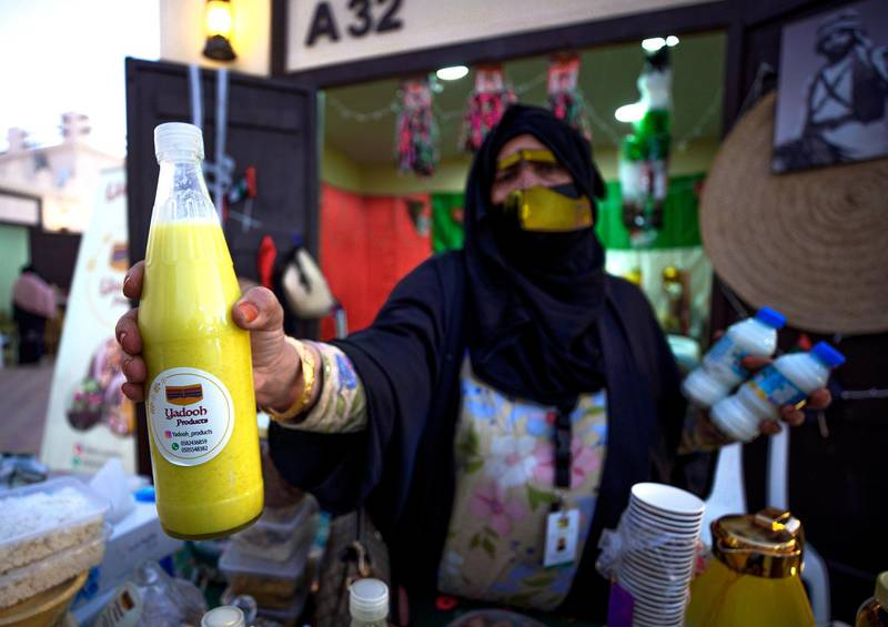 Abu Dhabi, United Arab Emirates, January 10, 2021.  A saleslady with some  Yadooh drinks at the Arabic market at Sheikh Zayed Festival.Victor Besa/The NationalSection:  NAReporter:  Saeed Saeed