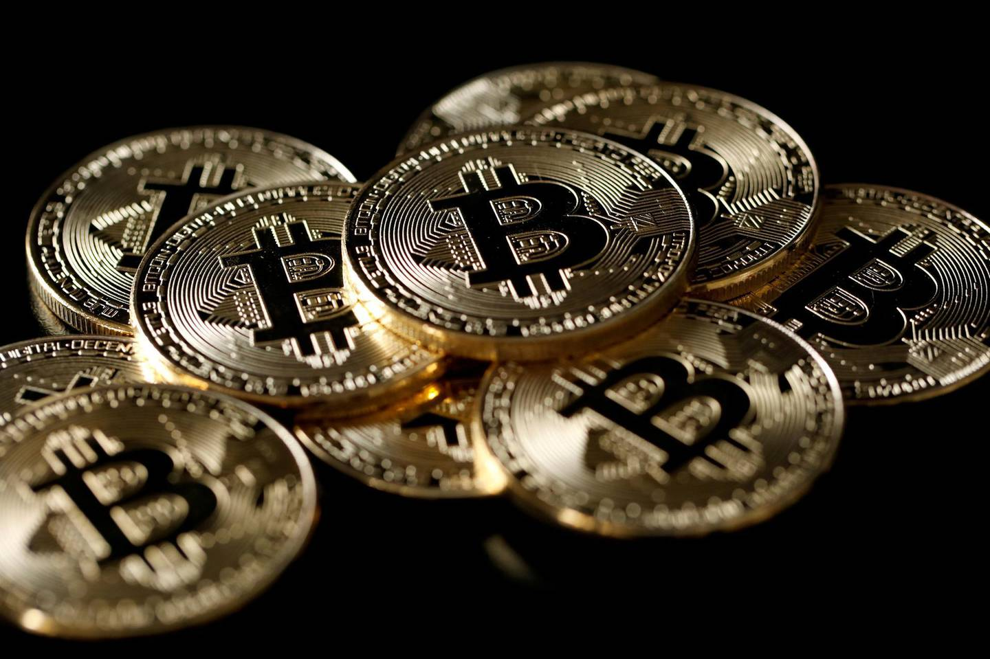 FILE PHOTO: A collection of Bitcoin (virtual currency) tokens are displayed in this picture illustration taken December 8, 2017. REUTERS/Benoit Tessier/File Photo