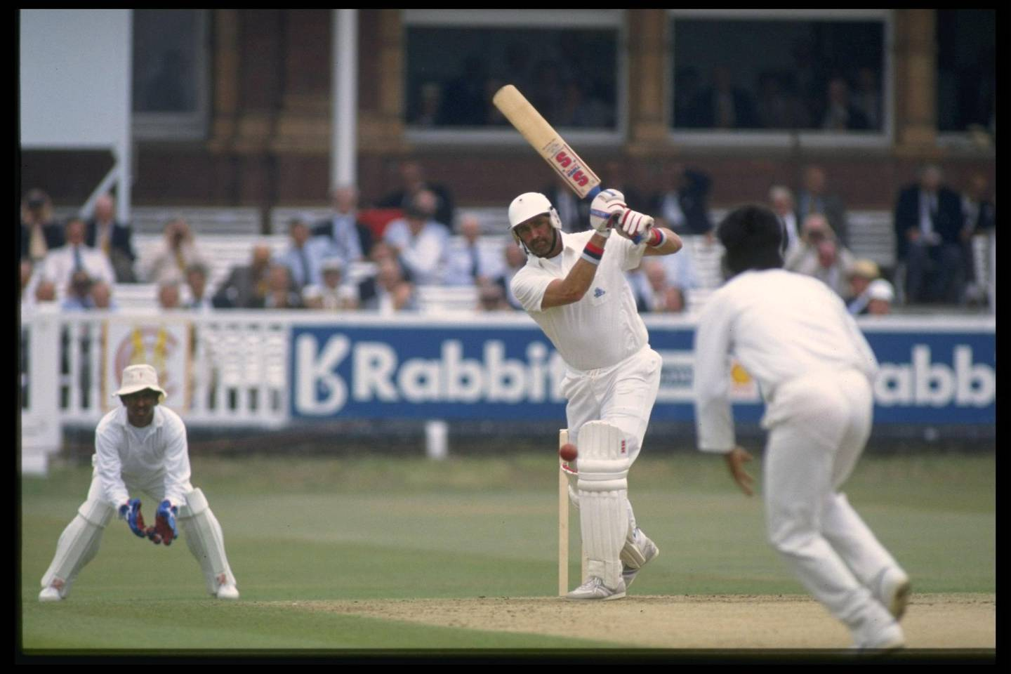 Aug 1990:  India wicket keeper Kiran More can only watch as Graham Gooch of England cover drives during his mammoth innings of 333 in the Test Match at Lords.                                    Mandatory Credit: Adrian Murrell/Allsport UK
