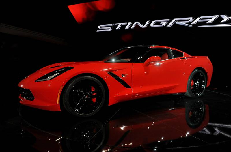 The 2014 Chevrolet Corvette Stingray is displayed after being unveiled ahead of the 2013 North American International Auto Show (NAIAS) in Detroit, Michigan, U.S., on Sunday, Jan. 13, 2013. The new model, set to reach dealers in this year's third quarter, is part of the push to breathe new life into the Chevy brand, which accounted for 71 percent of GM's 2012 U.S. sales. Photographer: Daniel Acker/Bloomberg  *** Local Caption ***  1148260.jpg