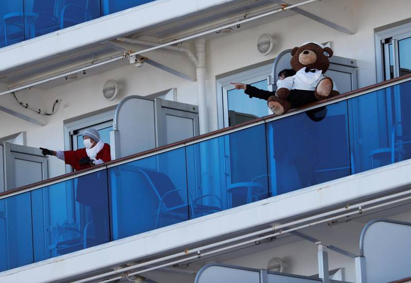 Passengers talk to each other on the balconies of their cabins on the cruise ship Diamond Princess, where dozens of passengers were tested positive for coronavirus, at Daikoku Pier Cruise Terminal in Yokohama, south of Tokyo, Japan, February 11, 2020. REUTERS/Issei Kato
