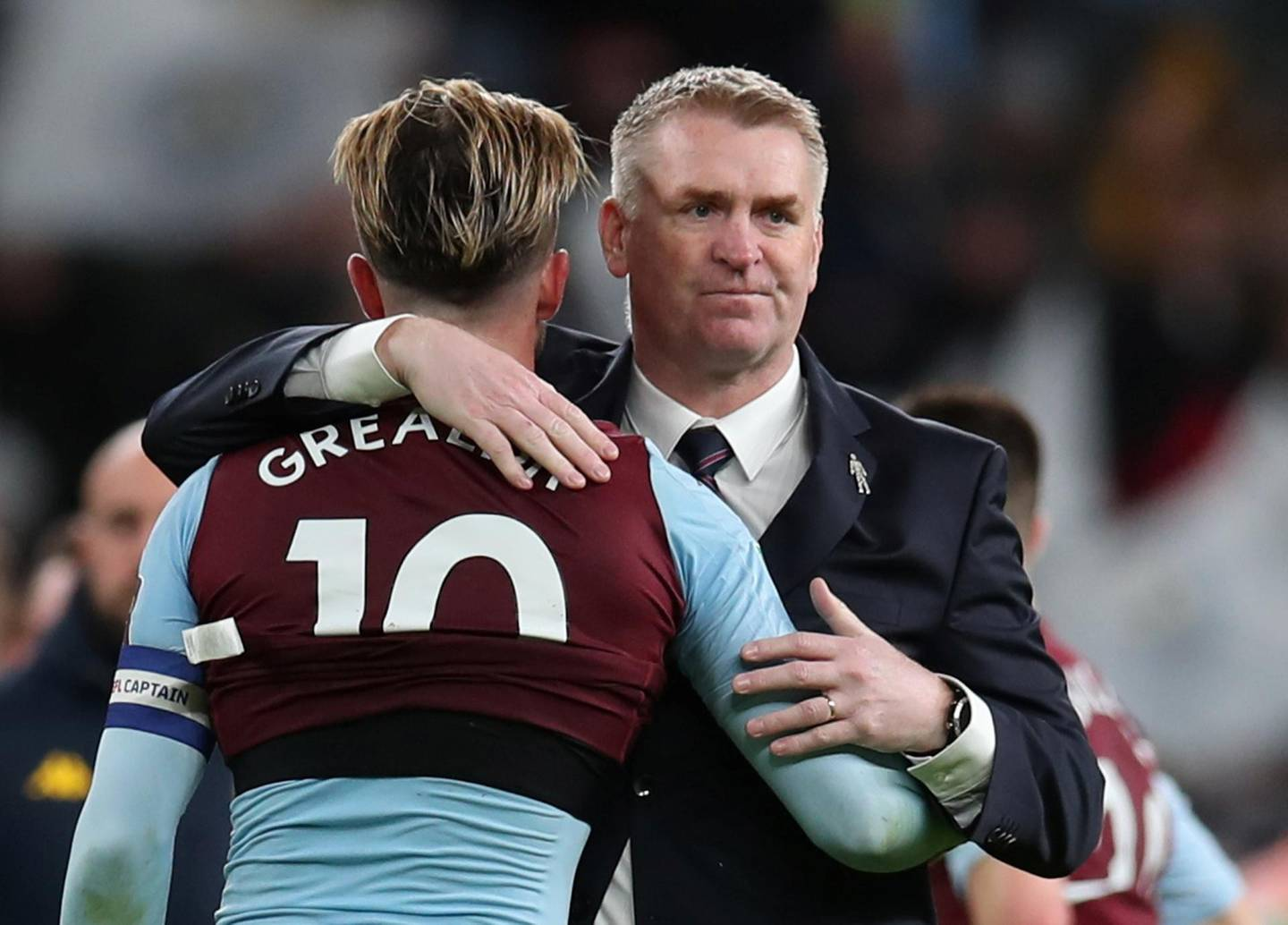 """Soccer Football - Carabao Cup Final - Aston Villa v Manchester City - Wembley Stadium, London, Britain - March 1, 2020  Aston Villa's Jack Grealish and Aston Villa manager Dean Smith hug after the match  REUTERS/Chris Radburn  EDITORIAL USE ONLY. No use with unauthorized audio, video, data, fixture lists, club/league logos or """"live"""" services. Online in-match use limited to 75 images, no video emulation. No use in betting, games or single club/league/player publications.  Please contact your account representative for further details."""
