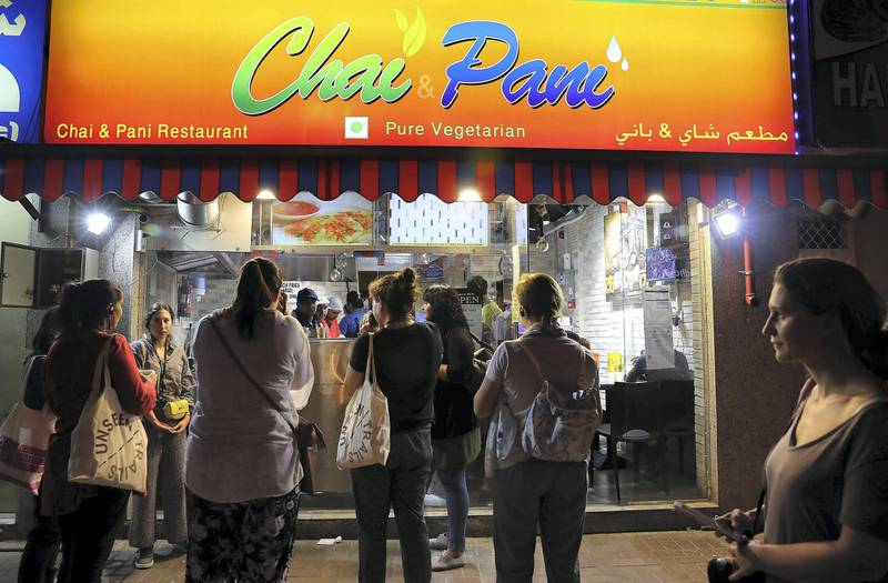 DUBAI , UNITED ARAB EMIRATES , MAY 23 – 2018 :- Participants having snacks and tea at the Chai Pani shop  during the Unseen Trails Iftar Walk presented by Gulf Photo Plus and Frying Pan Adventures in Bur Dubai area in Dubai.  ( Pawan Singh / The National )  For Weekender
