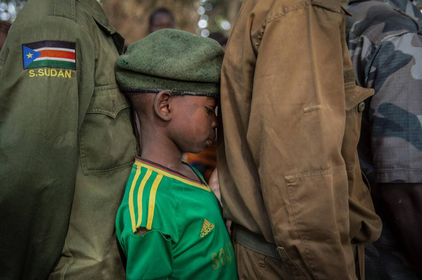 -- AFP PICTURES OF THE YEAR 2018 --  Newly released child soldiers wait in a line for their registration during the release ceremony in Yambio, South Sudan, on February 7, 2018. More than 300 child soldiers, including 87 girls, have been released in South Sudan's war-torn region of Yambio under a programme to help reintegrate them into society, the UN said on on Februar y 7, 2018. A conflict erupted in South Sudan little more than two years after gained independence from Sudan in 2011, causing tens of thousands of deaths and uprooting nearly four million people. The integration programme in Yambio, which is located in the south of the country, aims at helping 700 child soldiers return to normal life. -   / AFP / Stefanie Glinski