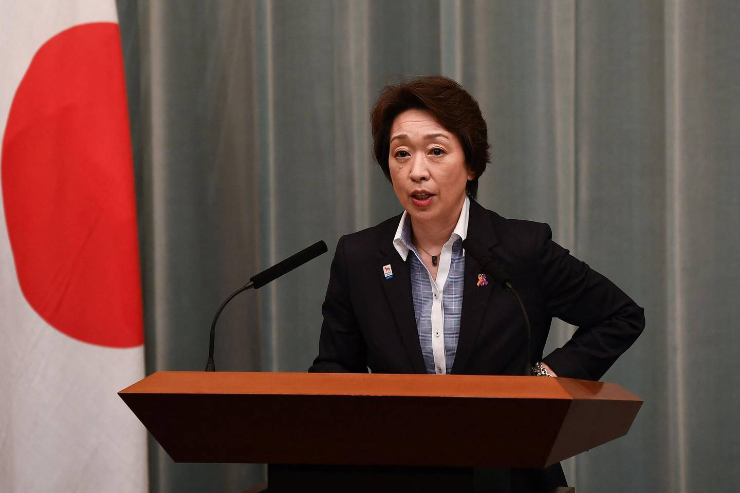 (FILES) In this file photo taken on September 17, 2020 Japan's Minister for the Tokyo Olympic and Paralympic Games Seiko Hashimoto delivers a speech during a press conference at the Prime Minister's office in Tokyo. Japan's Olympic Minister Seiko Hashimoto has been chosen as the top candidate to replace Tokyo 2020 chief Yoshiro Mori after he resigned over a sexism row, reports said on February 17, 2021. / AFP / Charly TRIBALLEAU