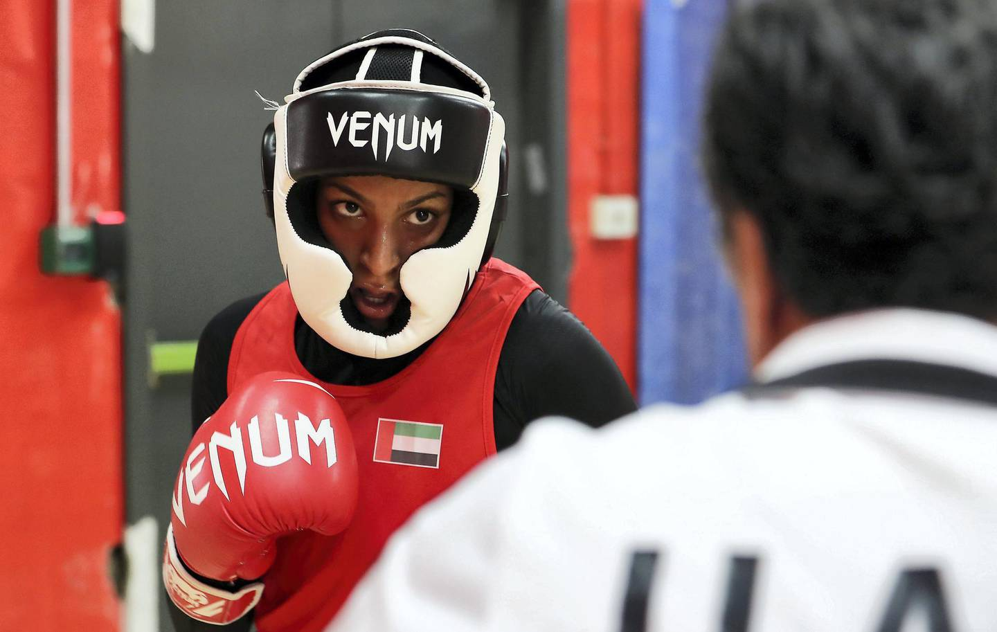 ABU DHABI,  UNITED ARAB EMIRATES , JUNE 16 – 2019 :- Khasan Mukhamedov , National team coach giving boxing training  to Hanan Ibrahim Alzyodi ( left )  at the UAE Boxing Federation HQ located at the Zayed Sports City Football stadium in Abu Dhabi. ( Pawan Singh / The National ) For Sport. Story by Amith