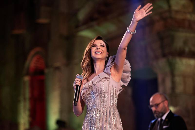 epa07730337 Lebanese singer Nancy Ajram performs during the 2019 Jerash Festival of Culture and Arts at the Jerash archeological site, Jerash, some 46 km North of Amman, Jordan, 20 July 2019. The Jerash festival takes part from 18 to 27 July 2019.  EPA/ANDRE PAIN