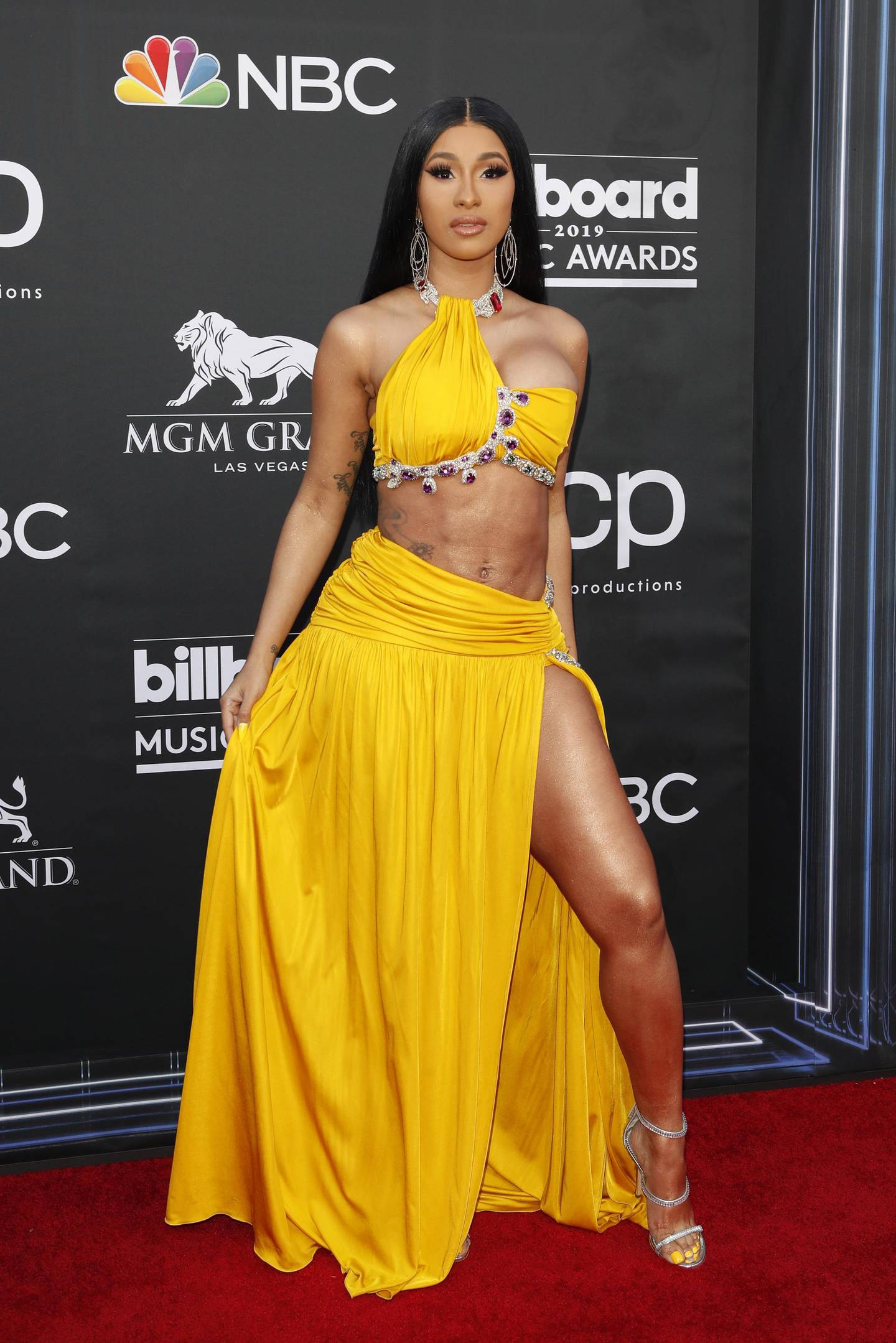 epa07541568 US rapper Cardi B arrives for the 2019 Billboard Music Awards at the MGM Grand Garden Arena in Las Vegas, Nevada, USA, 01 May 2019. The Billboard Music Awards finalists are based on US year-end chart performance, sales, number of downloads and total airplay.  EPA/NINA PROMMER