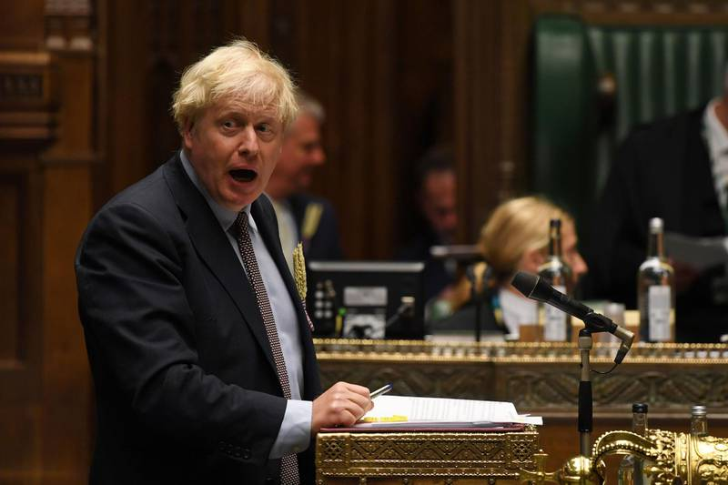 """A handout photograph released by the UK Parliament shows Britain's Prime Minister Boris Johnson during Prime Minister's Questions (PMQs) in the House of Commons in London on September 9, 2020.  British Prime Minister Boris Johnson was accused Wednesday of presiding over a """"rogue state"""" as his government introduced legislation that intentionally breaches its EU withdrawal treaty in the messy countdown to a full Brexit divorce. - RESTRICTED TO EDITORIAL USE - MANDATORY CREDIT """" AFP PHOTO / UK PARLIAMENT """" - NO USE FOR ENTERTAINMENT, SATIRICAL, MARKETING OR ADVERTISING CAMPAIGNS - EDITORS NOTE THE IMAGE HAS BEEN DIGITALLY ALTERED AT SOURCE TO OBSCURE VISIBLE DOCUMENTS  / AFP / UK PARLIAMENT / JESSICA TAYLOR / RESTRICTED TO EDITORIAL USE - MANDATORY CREDIT """" AFP PHOTO / UK PARLIAMENT """" - NO USE FOR ENTERTAINMENT, SATIRICAL, MARKETING OR ADVERTISING CAMPAIGNS - EDITORS NOTE THE IMAGE HAS BEEN DIGITALLY ALTERED AT SOURCE TO OBSCURE VISIBLE DOCUMENTS"""