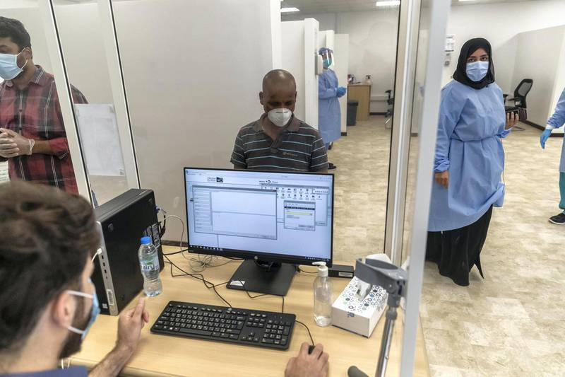 ABU DHABI, UNITED ARAB EMIRATES. 16 APRIL 2020. COVID-19 Testing station in Al Mussafah. A man registers for his test. (Photo: Antonie Robertson/The National) Journalist: Haneen Dajani. Section: National.