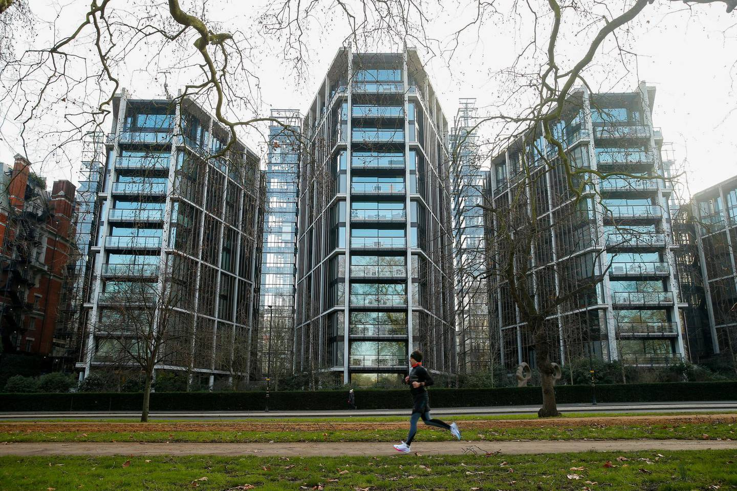 A jogger passes One Hyde Park, a luxury residential and retail complex, in Knightsbridge, London, U.K., on Thursday, Jan. 7, 2021. Persimmon Plc, the U.K.s biggest housebuilder, said the long-term outlook for the countrys housing market remained resilient despite the economic gloom and latest national lockdown. Photographer: Hollie Adams/Bloomberg via Getty Images