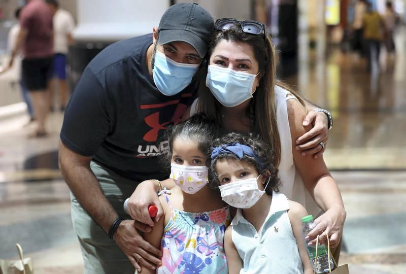 Dubai, United Arab Emirates - Reporter: Kelly Clarke. Coronavirus/Covid-19. Farah Altaher (mum), Ghaith Ghnimat (dad), Ghazal Ghnimat (L) and Yara Ghnimat. Parents rush to buy PPE for children in time for back-to-school. Sunday, August 23rd, 2020. Dubai. Chris Whiteoak / The National