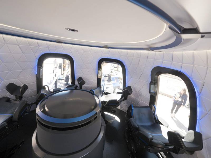 The interior the high fidelity crew capsule mock up of the Blue Origin LLC New Shepard system sits on display during the Space Symposium in Colorado Springs, Colorado, U.S., on Wednesday, April 5, 2017. Jeff Bezos, chief executive officer of Amazon.com Inc. and founder of Blue Origin, has been reinvesting money he made at Amazon since he started his space exploration company more than a decade ago, and has plans to launch paying tourists into space within two years. Photographer: Matthew Staver/Bloomberg