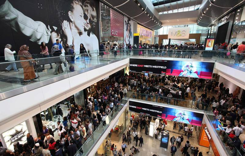 FILE PHOTO: Shoppers crowd the walkways on opening day of the Westfield Stratford City shopping centre in east London September 13, 2011.   REUTERS/Suzanne Plunkett/File Photo