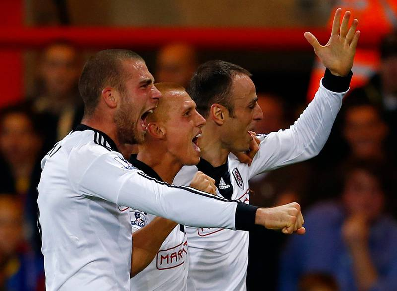 """Fulham's Dimitar Berbatov (R) celebrates his goal against Crystal Palace with teammates Steve Sidwell (C) and Pajtim Kasami during their English Premier League soccer match at Selhurst Park in London October 21, 2013.  REUTERS/Eddie Keogh (BRITAIN - Tags: SPORT SOCCER) NO USE WITH UNAUTHORIZED AUDIO, VIDEO, DATA, FIXTURE LISTS, CLUB/LEAGUE LOGOS OR """"LIVE"""" SERVICES. ONLINE IN-MATCH USE LIMITED TO 45 IMAGES, NO VIDEO EMULATION. NO USE IN BETTING, GAMES OR SINGLE CLUB/LEAGUE/PLAYER PUBLICATIONS. FOR EDITORIAL USE ONLY. NOT FOR SALE FOR MARKETING OR ADVERTISING CAMPAIGNS *** Local Caption ***  EDY12_SOCCER-ENGLAN_1021_11.JPG"""