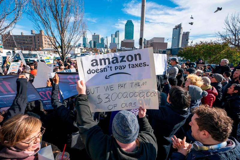 """Protesters gather in Long Island City to say """"No"""" to the Amazon """"HQ2"""" decision on November 14, 2018 in Long Island City, New York.                           It's exciting for some, worrisome for others: The arrival of a massive headquarters of technology giant Amazon in two East Coast communities is certain to bring huge changes. Amazon announced Tuesday after a yearlong search that it would split its """"HQ2"""" between Arlington, Virginia, outside the US capital, and the Long Island City neighborhood in the New York borough of Queens.  / AFP / Don EMMERT"""