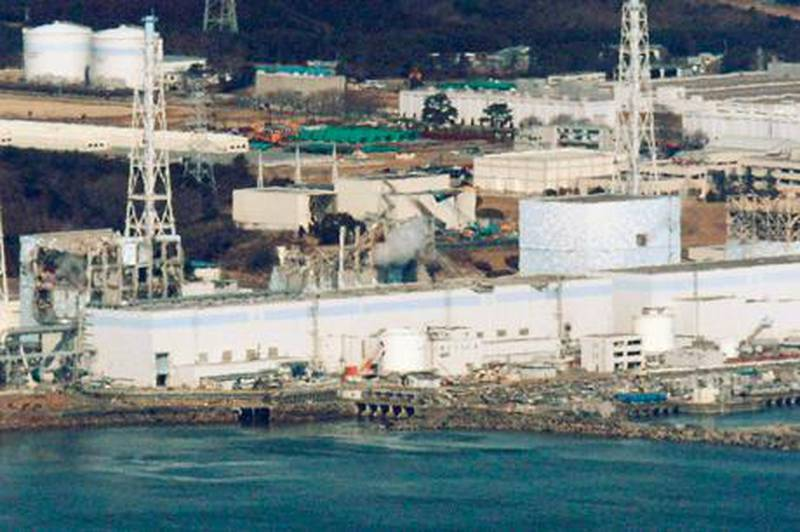 An aerial view shows Fukushima Daiichi nuclear power plant in Fukushima March 17, 2011. Reactors 1 to 4 are seen from R to L in this picture taken more than 30km (18 miles) offshore from the site shortly before the start of the water-dropping operation. Operators of the quake-crippled nuclear plant in Japan again deployed military helicopters on Thursday in a bid to douse overheating reactors, as U.S. officials warned of the rising risk of a catastrophic radiation leak from spent fuel rods.   REUTERS/Kyodo (JAPAN - Tags: MILITARY DISASTER ENVIRONMENT ENERGY IMAGES OF THE DAY) FOR EDITORIAL USE ONLY. NOT FOR SALE FOR MARKETING OR ADVERTISING CAMPAIGNS. JAPAN OUT. NO COMMERCIAL OR EDITORIAL SALES IN JAPAN. YES *** Local Caption ***  SIN41R_JAPAN-QUAKE-_0317_11.JPG