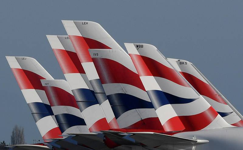 FILE PHOTO: Tail Fins of British Airways planes are seen parked at Heathrow airport, in Britain, March 31, 2020. REUTERS/Toby Melville/File Photo