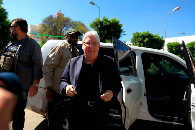 """UN envoy to Yemen Martin Griffiths (C) arrives for a meeting with the President of the Huthi Revolutionary Committee, in the capital Sanaa, on November 24, 2018. In a possible breakthrough despite government scepticism, the envoy said that he discussed with Huthi rebel officials """"how the UN could contribute to keeping the peace"""" in the key port city of Hodeida. Griffiths met a Yemeni rebel leader in insurgent-held Sanaa Saturday and is to follow up by holding talks with Yemen's government in Riyadh, a UN source said. / AFP"""