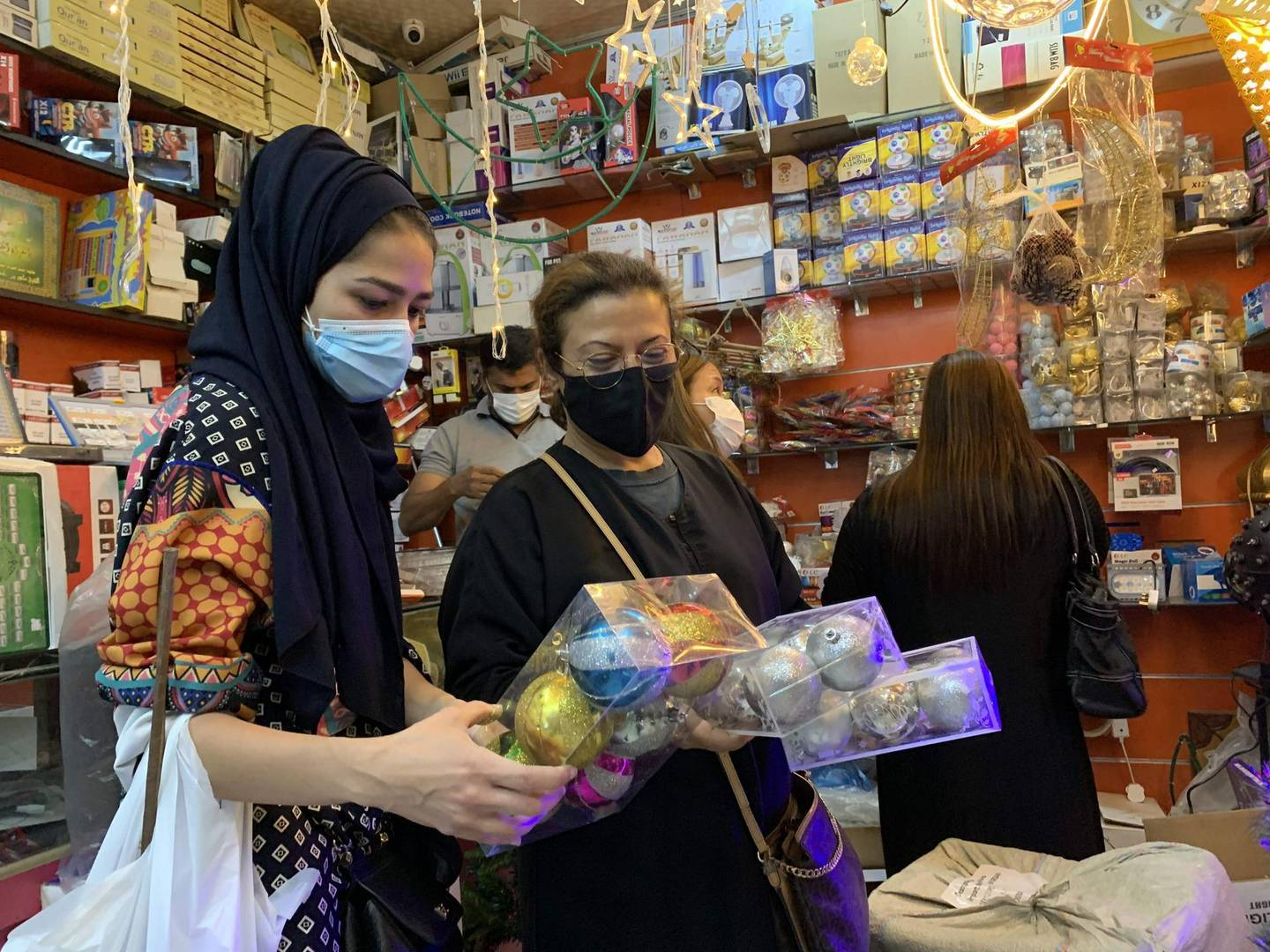 Expats living in Saudi Arabia choose Christmas decorations at a gift shop in the capital Riyadh on December 7, 2020. Until barely three years ago, such items were almost impossible to be openly sold in Saudi Arabia, where authorities have clipped the powers of the clerical establishment long notorious for enforcing Islamic traditions. For decades, Christmas sales were largely underground, and Christians from the Philippines, Lebanon and other countries celebrated the festival behind closed doors or in expat enclaves. / AFP / FAYEZ NURELDINE