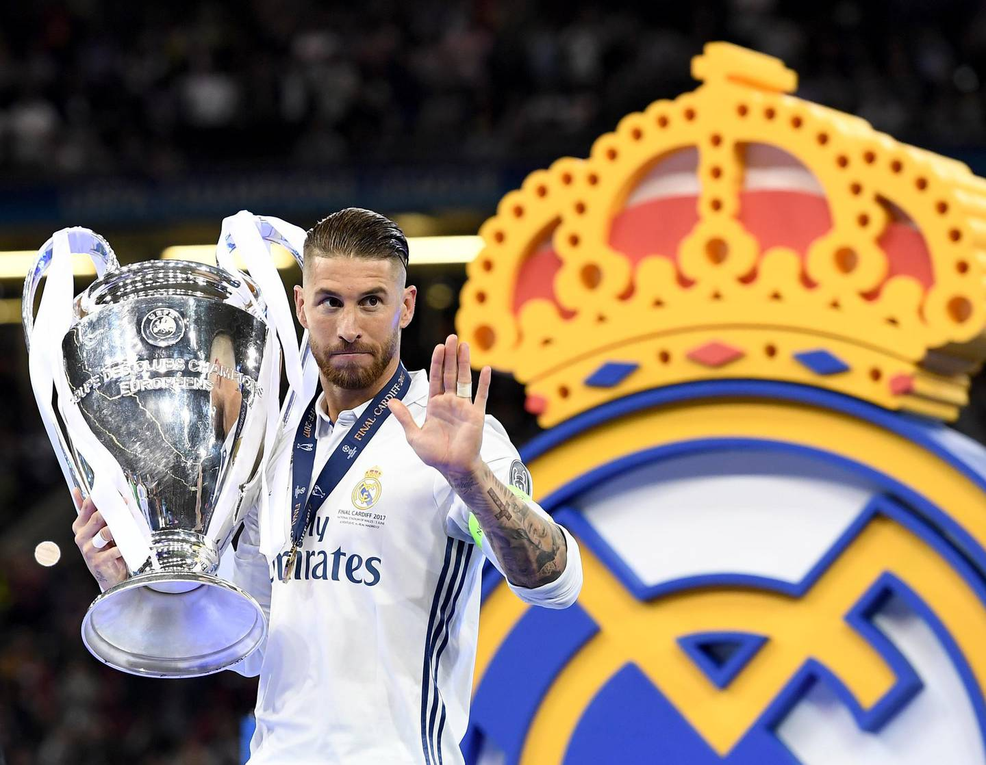 epa09278832 (FILE) - Real Madrid's Sergio Ramos receives the trophy after winning the UEFA Champions League final between Juventus FC and Real Madrid at the National Stadium of Wales in Cardiff, Britain, 03 June 2017 (reissued 17 June 2021). Real Madrid's icon Sergio Ramos will leave the club after his contract expires on 30 June 2021. The club announced to bid Ramos farewell on 17 June 2021 in a virtually held press conference.  EPA/ANDY RAIN *** Local Caption *** 53565189