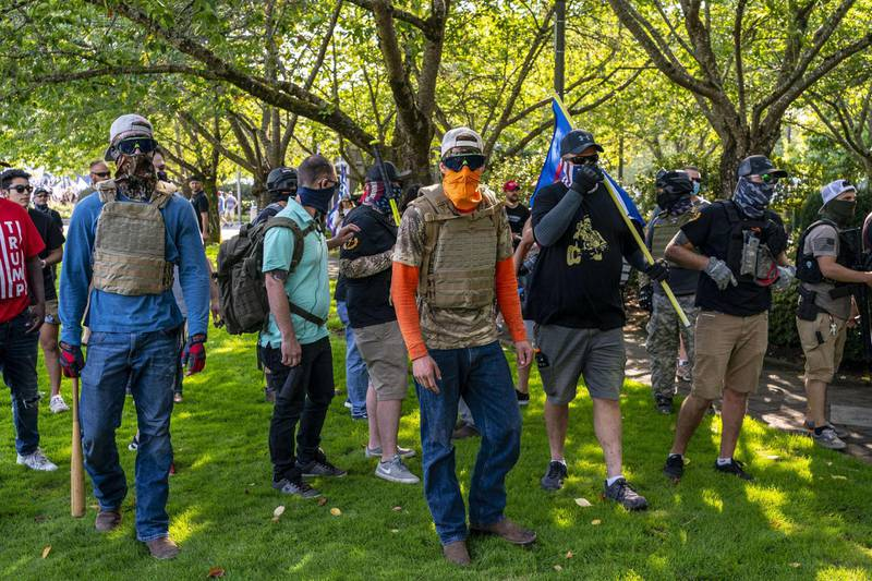SALEM, OR - SEPTEMBER 07: Proud Boys and other right wing demonstrators pursue counter-protesters after a pro-Trump caravan rally convened at the Oregon State Capitol building on September 7, 2020 in Salem, Oregon. The caravan event, billed as the Oregon For Trump 2020 Labor Day Cruise Rally, began in Clackamas and made its way to the Oregon State Capitol in Salem.   David Ryder/Getty Images/AFP == FOR NEWSPAPERS, INTERNET, TELCOS & TELEVISION USE ONLY ==