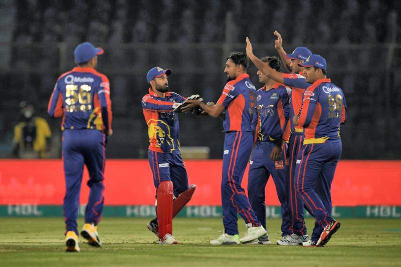 Karachi King's Waqas Maqsood (C) celebrates the wicket of Quetta Gladiators Ahmad Shahzad (unseen)during the Pakistan Super League (PSL) T20 cricket match between Karachi King's and Quetta Gladiators at the National Stadium in Karachi on March 15, 2020. (Photo by Asif HASSAN / AFP)