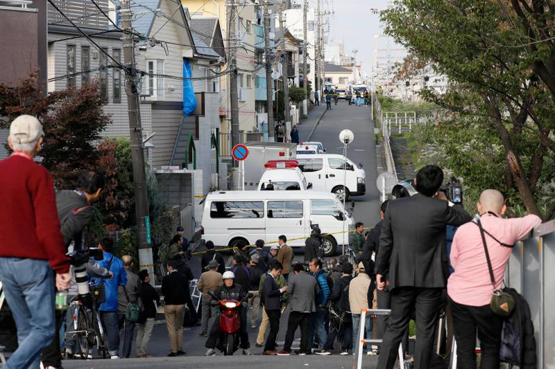 epa06299259 Police investigators and crime lab experts investigate an apartment house (L) in Zama, Kanagawa Prefecture, Japan, 31 October 2017. A 27-year-old man was arrested on 31 October after severed parts of nine bodies were found stored in cooler boxes in his apartment house in Zama, south of Tokyo, Japan.  EPA/KIMIMASA MAYAMA