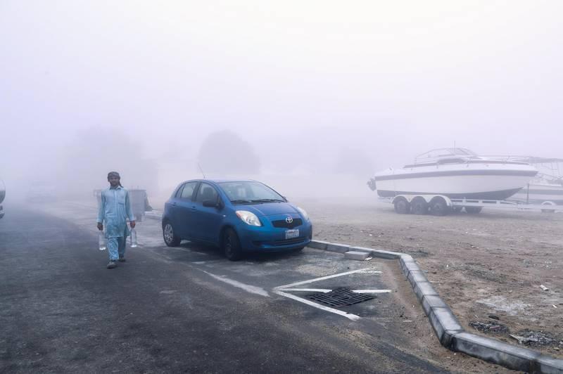 Abu Dhabi, U.A.E., January 15, 2018.  A worker walks through  8 a.m. Khalifa City fog.Victor Besa / The NationalNA