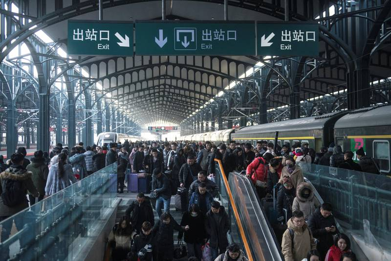 HARBIN, CHINA - JANUARY 21: Passengers make their way through Harbin Railway Station on January 21, 2019 in Harbin, China. About 2.99 billion trips are expected to be made during the 2019 Spring Festival travel rush between Jan 21 and March 1. The Spring Festival, or Chinese Lunar New Year, falls on Feb 5 this year. (Photo by Tao Zhang/Getty Images)