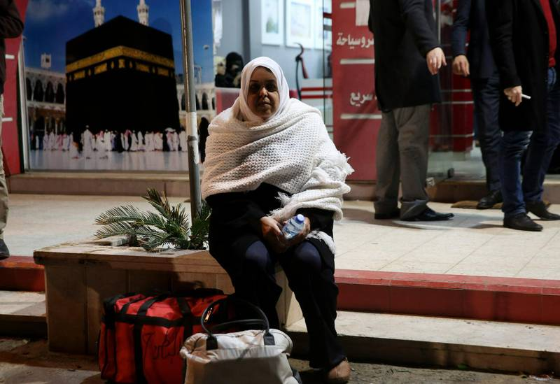 A Palestinians Muslim pilgrim waits for a bus en route to Rafah border between Gaza Strip and Egypt before leaving for the hajj pilgrimage to the holy city of Mecca, in Gaza City, Saturday, March 2, 2019. Gazan residents resume minor pilgrimage to Mecca after five years of Egyptian ban. (AP Photo/Adel Hana)