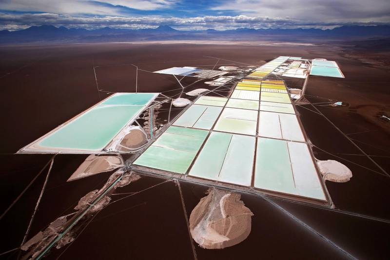 """An aerial view of the brine pools and processing areas of the Rockwood lithium plant on the Atacama salt flat, the largest lithium deposit currently in production, in the Atacama desert of northern Chile, January 10, 2013. Argentina, Chile and Bolivia hold the planet's largest reserves of lithium,  the world's lightest metal and a key component in batteries used to power a range of technologies from cell phones to laptops to electric cars. Industrial production from countries in this so-called """"lithium triangle"""" is already high. Chile is the world's leading source of the metal, turning out around 40 percent of global supply, and Argentina is also a significant producer. Output from the Andes may soon rise after Bolivia - the country that holds an estimated 50 percent of the world's lithium reserves - opened its first lithium pilot plant in January.   Picture taken January 10, 2013. REUTERS/Ivan Alvarado (CHILE - Tags: BUSINESS COMMODITIES ENVIRONMENT ENERGY TPX IMAGES OF THE DAY)   ATTENTION EDITORS:  PICTURE 23 34 FOR PACKAGE ' LITHIUM TRIANGLE' SEARCH 'LITHIUM TRIANGLE' FOR ALL - GM1E9451EQA01"""