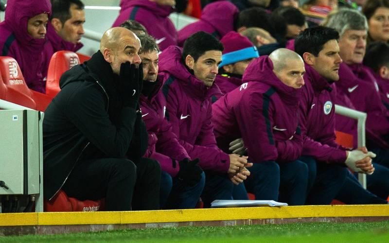 epa06438431 Manchester City manager Pep Guardiola (L) reacts during the English Premier League soccer match between Liverpool FC and Manchester City at Anfield in Liverpool, Britain, 14 January 2018. Liverpool won 4-3.  EPA/PETER POWELL EDITORIAL USE ONLY. No use with unauthorized audio, video, data, fixture lists, club/league logos or 'live' services. Online in-match use limited to 75 images, no video emulation. No use in betting, games or single club/league/player publications