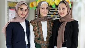 Triplet sisters share top score in high-school final exams