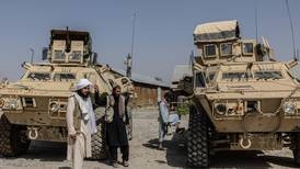 At Afghanistan's Ghazni military base, Taliban sift through spoils of war