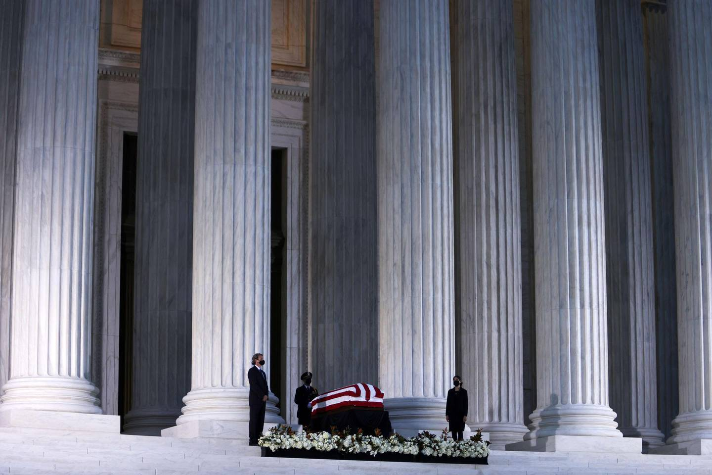WASHINGTON, DC - SEPTEMBER 23: Members of the public pay respects to Associate Justice Ruth Bader Ginsburg as her flag-draped casket rests on the Lincoln catafalque on the west front of the U.S. Supreme Court September 23, 2020 in Washington, DC. A pioneering lawyer and according the Chief Justice John Roberts 'a jurist of historic stature,' Ginsburg died September 18 at the age of 87 after a long battle against cancer.   Alex Wong/Getty Images/AFP == FOR NEWSPAPERS, INTERNET, TELCOS & TELEVISION USE ONLY ==