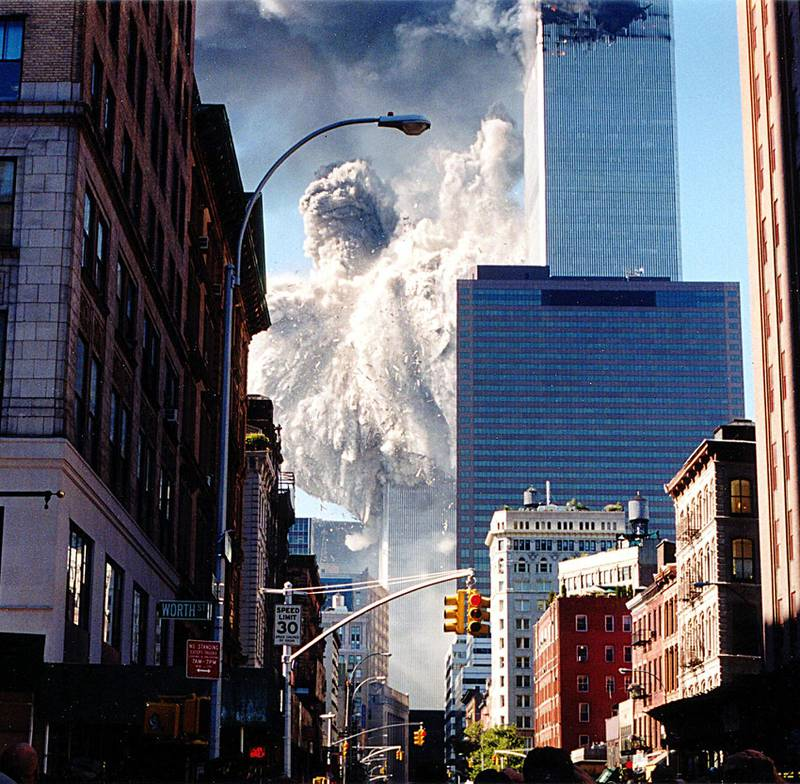 The south tower of the World Trade Center collapses sending dust and smoke into the streets 11 September, 2001, in New York. Two planes crashed into the towers which later collapsed.  AFP PHOTO/Aaron MILESTONE (Photo by AARON MILESTONE / AFP)