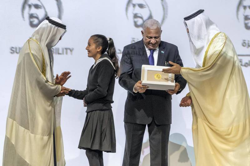 ABU DHABI, UNITED ARAB EMIRATES. 13 JANUARY 2020. The Zayed Sustainability Awards held at ADNEC as part of Abu Dhabi Sustainability Week. H.E. Sheikh Mohammed bin Zayed Al Nahyan, Crown Prince of Abu Dhabi and Deputy Supreme Commander of the United Arab Emirates Armed Forces awards Global High Schools Winner: South Asia, Bloom Nepal School, Nepal with the Prime Minister of Fiji, Frank Bainimarama. (Photo: Antonie Robertson/The National) Journalist: Kelly Clarker. Section: National.