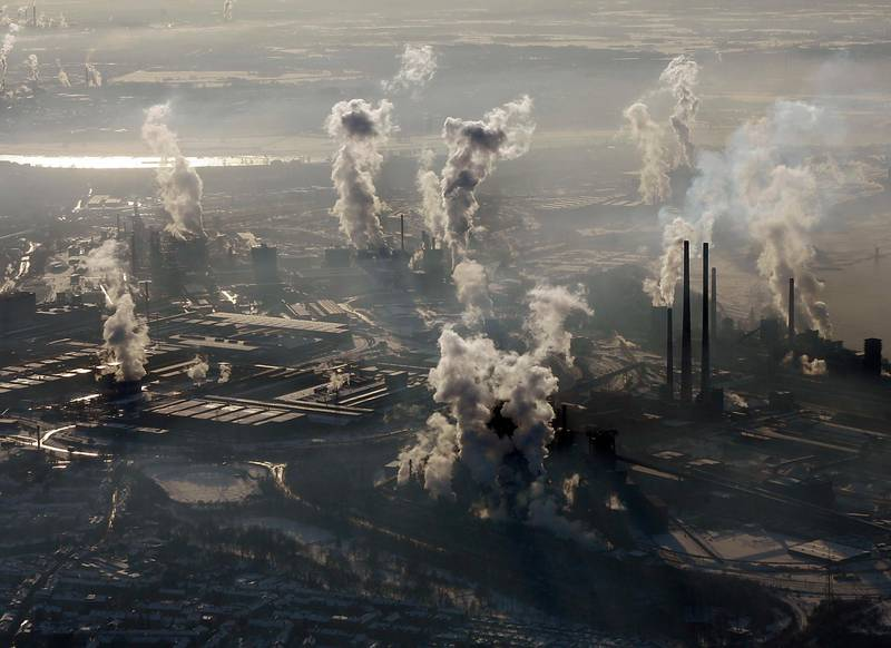 FILE - In this Jan. 9, 2009 file photo smoke rises from the steel company ThyssenKrupp in Duisburg , western Germany. Levels of carbon dioxide in the atmosphere have steadily increased since the days of the industrial revolution, contributing to the greenhouse effect that is spurring global warming.  (AP Photo/Frank Augstein, file)