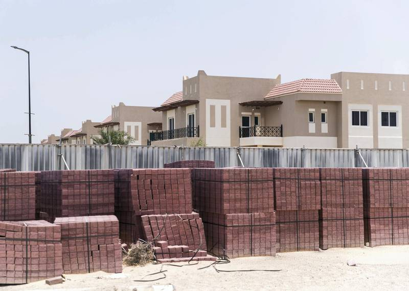 DUBAI, UNITED ARAB EMIRATES - JULY 15 2019.Ungated construction sites around the neighborhood at Living Legends.Some residents and investors of Living Legends have paid Dh6m for villas, and pay Dh25,000 a year in service charges but the development still looks like a construction site, with an unfinished golf course, roads, open sewer works near the school, poor lighting and no desert boundary meaning dangerous snakes and animals are regularly getting into the gardens and villas. (Photo by Reem Mohammed/The National)Reporter: NICK WEBSTERSection: NA