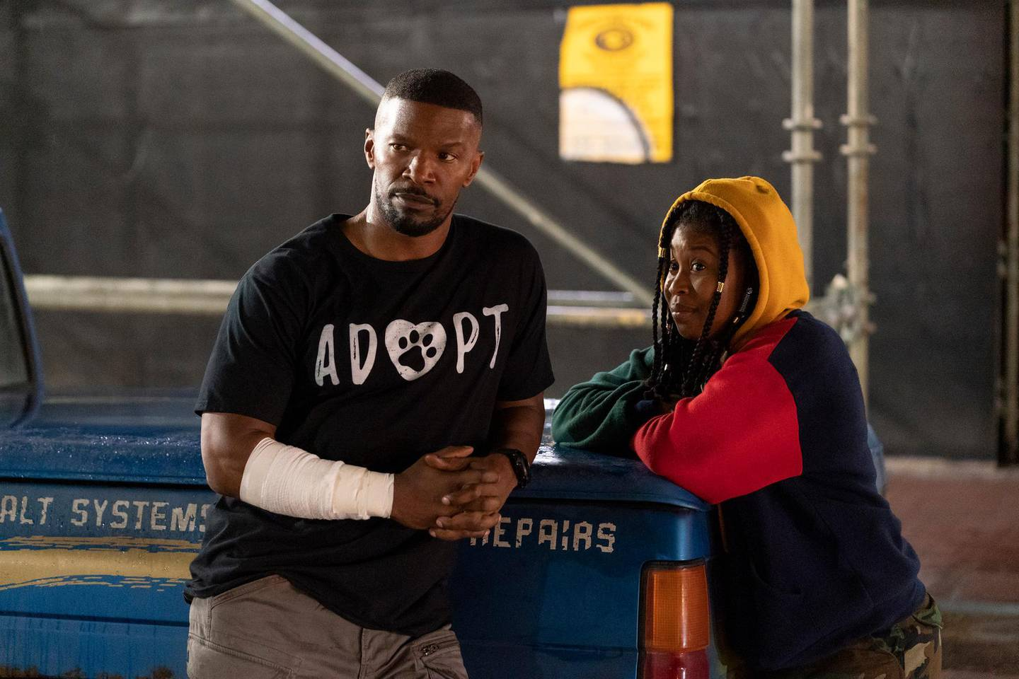"""This image released by Netflix shows Jamie Foxx, left, and Dominique Fishback in a scene from """"Project Power."""" The film, streaming Friday, imagines a world where a pill can give temporary superpowers. (Skip Bolen/Netflix via AP)"""