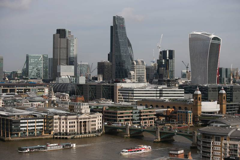 (FILES) This file photo taken on October 27, 2016 shows boats cruising along the Thames as the City of London's skyline is seen from the Tate Modern museum in London. In a bid to expose the murky Nigerian money lurking behind some of London's most high-end properties, anti-corruption campaigners are offering an unusual property tour of the British capital, October 6, 2017. / AFP PHOTO / Daniel LEAL-OLIVAS