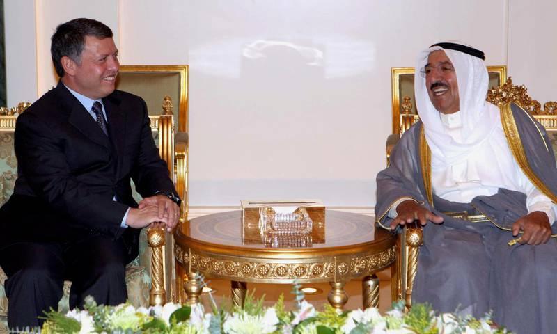 Emir of Kuwait Sabah Al-Ahmad Al-Jaber Al-Sabah (R) meets Jordan's King Abdullah upon his arrival in Kuwait September 16, 2008.     REUTERS/Yousef Allan   (KUWAIT)