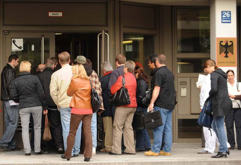 Job seekers enter a federal employment office in Munich, Germany, on Tuesday, April 27, 2010. Germany's unemployment figures will be released this week. Photographer: Guido Krzikowski/Bloomberg via Getty Images