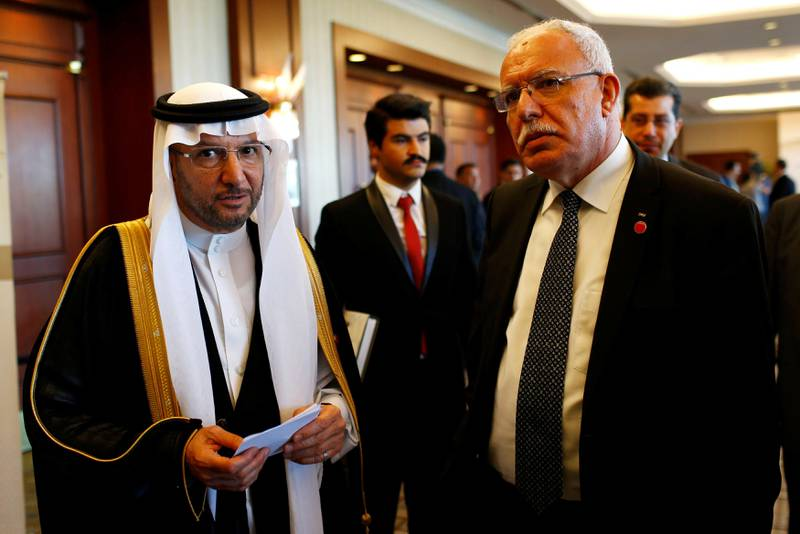 Secretary General of Organization of Islamic Cooperation (OIC) Yousef bin Ahmad Al-Othaimeen chats with Palestinian Foreign Minister Riyad Al-Maliki during an extraordinary meeting of the OIC Executive Committee in Istanbul, Turkey, August 1, 2017. REUTERS/Murad Sezer