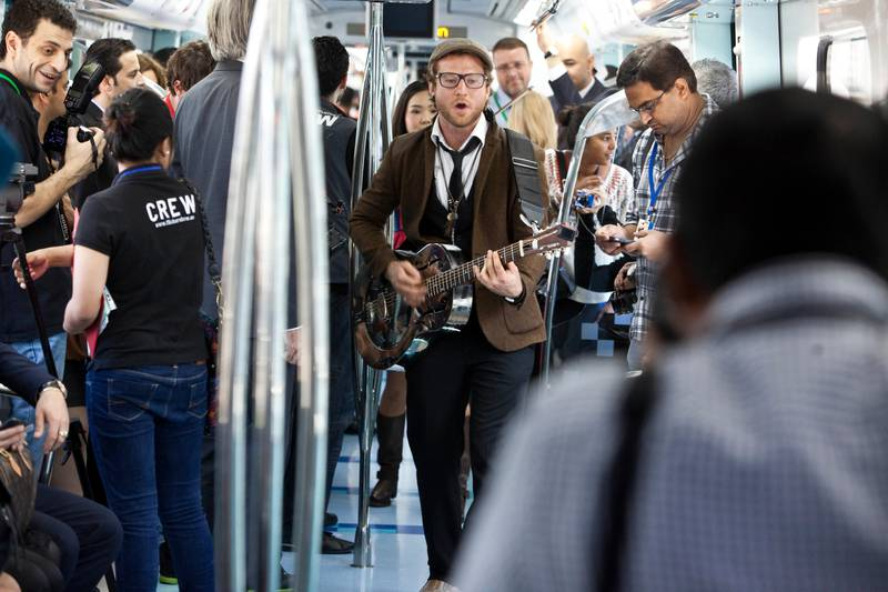DUBAI, UNITED ARAB EMIRATES,  January 23, 2013. Tim Hassal (with guitar) and Co perform during the Fashion Train show by Dubai Shopping Festival and Bloomingdales where a fashion show was held on the Dubai Metro. (ANTONIE ROBERTSON / The National)