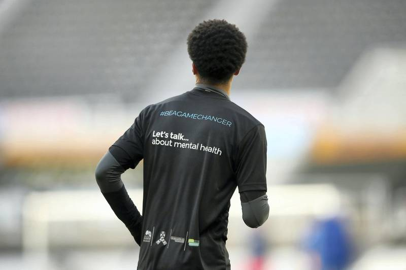NEWCASTLE UPON TYNE, ENGLAND - NOVEMBER 21: Jamal Lewis of Newcastle United is seen wearing a Be a game changer t-shirt in support of lets talk about mental health prior to the Premier League match between Newcastle United and Chelsea at St. James Park on November 21, 2020 in Newcastle upon Tyne, England. Sporting stadiums around the UK remain under strict restrictions due to the Coronavirus Pandemic as Government social distancing laws prohibit fans inside venues resulting in games being played behind closed doors. (Photo by Alex Pantling/Getty Images)