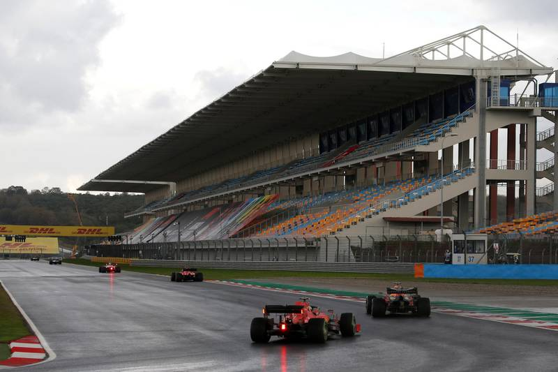FILE PHOTO: Formula One F1 - Turkish Grand Prix - Istanbul Park, Istanbul, Turkey - November 15, 2020 Ferrari's Charles Leclerc and Red Bull's Alexander Albon in action during the race REUTERS/Kenan Asyali/File Photo