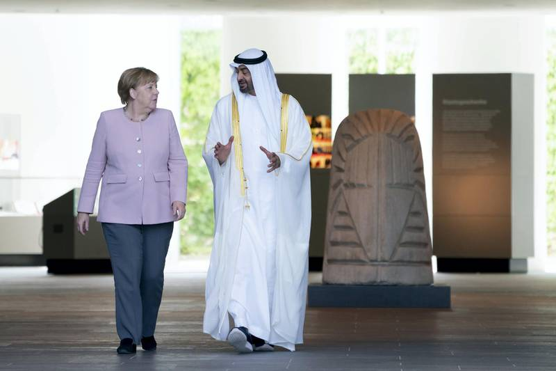 BERLIN, GERMANY - June 12, 2019: HE Angela Merkel, Chancellor of Germany (L), bids farewell to HH Sheikh Mohamed bin Zayed Al Nahyan, Crown Prince of Abu Dhabi and Deputy Supreme Commander of the UAE Armed Forces (R), after a meeting at the Chancellor's Office in Berlin, Germany.   (Eissa Al Hammadi / For the Ministry of Presidential Affairs )