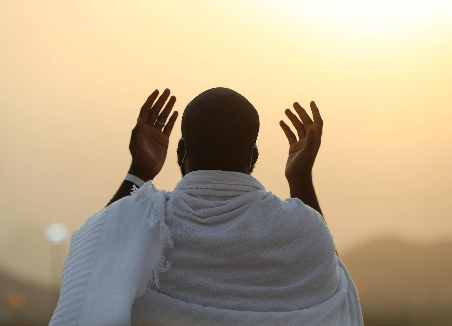 """A handout picture provided by Saudi Ministry of Media on July 30, 2020 shows a Mulism pilgrim praying on Mount Arafat, also known as Jabal al-Rahma (Mount of Mercy), southeast of the holy city of Mecca, during the climax of the Hajj pilgrimage amid the COVID-19 pandemic. Muslim pilgrims converged today on Saudi Arabia's Mount Arafat for the climax of this year's hajj, the smallest in modern times and a sharp contrast to the massive crowds of previous years. - === RESTRICTED TO EDITORIAL USE - MANDATORY CREDIT """"AFP PHOTO / HO / SAUDI MINISTRY OF MEDIA"""" - NO MARKETING NO ADVERTISING CAMPAIGNS - DISTRIBUTED AS A SERVICE TO CLIENTS ===  / AFP / Saudi Ministry of Media / Saudi Ministry of Media / STR / === RESTRICTED TO EDITORIAL USE - MANDATORY CREDIT """"AFP PHOTO / HO / SAUDI MINISTRY OF MEDIA"""" - NO MARKETING NO ADVERTISING CAMPAIGNS - DISTRIBUTED AS A SERVICE TO CLIENTS ==="""